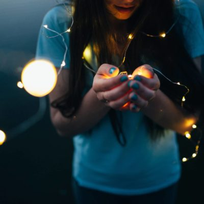 girl with lights in hands