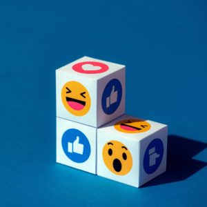 Kyiv, Ukraine - September 9, 2019: A paper cubes with printed emojis from Facebook Messenger, one of the biggest and world-famous social network.