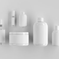 Close up of blank white make-up or medicine packaging objetcs. Advertisement concept. Mock up, 3D Rendering